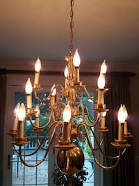gold-colored and beige uplight chandelier