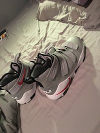 pair of gray-and-red Nike basketball shoes Edmonton, T6R 3V9