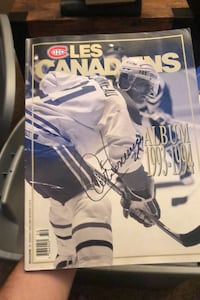 Signed 93-94 canadians magazine by Guy Carbonneau