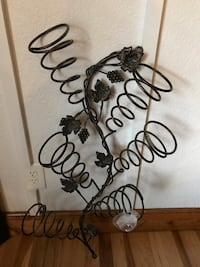 Metal wine rack. I paid $50 for it on sale at an expensive decor store, will sell for $25.