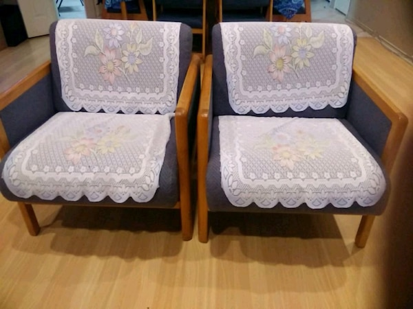 two white floral padded chairs