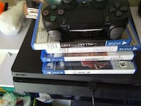 black Sony PS4 console with controller and game ca Edmonton, T5R 2R7