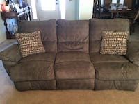Dual reclining sofa. Clean, pet free, smoke free home. Both recliners in good working condition. Prairie Grove, 72753