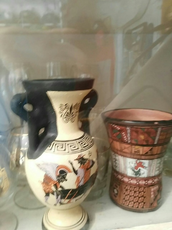 two white and brown ceramic items