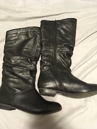pair of black leather side-zip knee-high boots