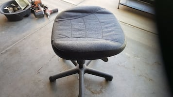 gray fabric armless rolling chair