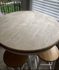 round brown wooden table with four chairs dining set Ashburn, 20147