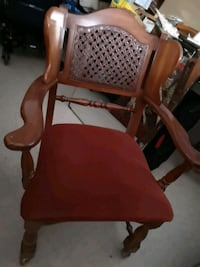 brown wooden framed red padded armchair 469 km
