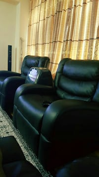 two black leather sofa chairs