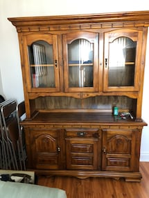 Brown wooden china cabinet with cabinet