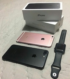 rose gold iPhone 6s plus; black iPhone 7 plus; space black case Apple watch with black classic band