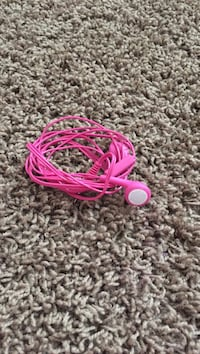 pink and white corded earphones