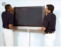 flat-screen television and men's black polo shirt and white pants
