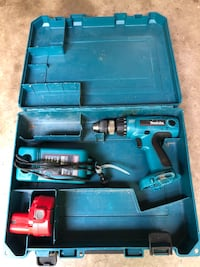 blue and black Makita cordless hand drill in case Alexandria