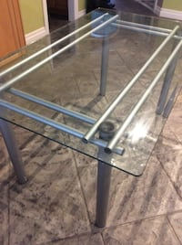 Glass top dining table  Milton, L9T 8G1