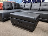Brand new in box black faux leather sectional includes storage Ottoman College Park