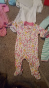 baby's white, pink, and yellow footie pajama