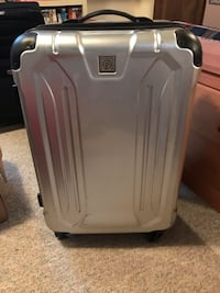 """Silver hard shell suitcase -23"""" x 16"""" - a few small scratches  Sykesville, 21784"""