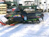 Used Red Black And Yellow Snowmobile For Sale In Buffalo