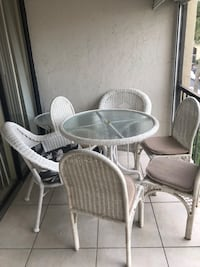 round glass-top table with four chairs Boca Raton, 33432