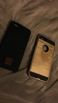 Two black and brown iPhone cases