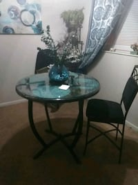 round glass top table with black metal base Kissimmee, 34741
