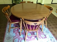 oval brown wooden table with four chairs dining set 42 km
