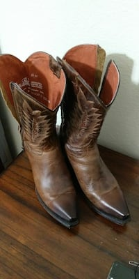 pair of brown x-toe cowboy boots