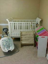 white wooden crib with gray magazine rack and baby's white cradle n swing Newport News, 23601