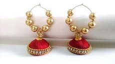 red-and-gold jhumka earrings