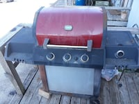red and black 4-burner gas grill