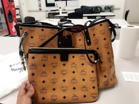 women's brown and black leather MCM tote bag