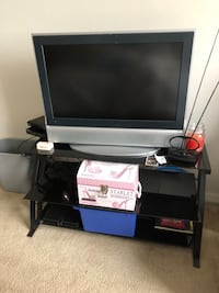 black flat screen TV with black wooden TV stand Falls Church, 20598