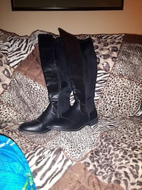 pair of black leather knee-high boots Rothesay, E2E 2N1