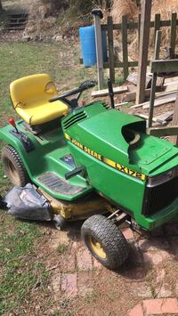 Green and yellow john deere ride on lawn mower Silver Spring, 20904