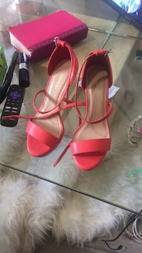 pair of red leather open-toe ankle strap heels Abbotsford, V2S 3H3