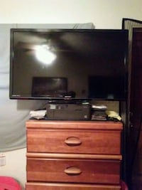 black flat screen TV and brown wooden TV stand Ocala, 34470