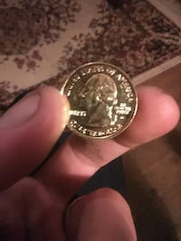 24 KT gold platted NY State Quarter.