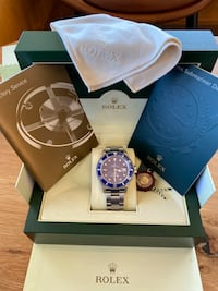 PREOWNED ROLEX SUBMARINER STEEL AUTH CUSTOM BLUE 40mm 16610 Blue Silver Spring