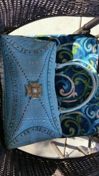 Aqua blue leather purse from The Find.   Albuquerque, 87114