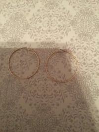 women's pair of gold hoop earrings