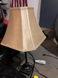 black metal base with beige lampshade table lamp Huntersville