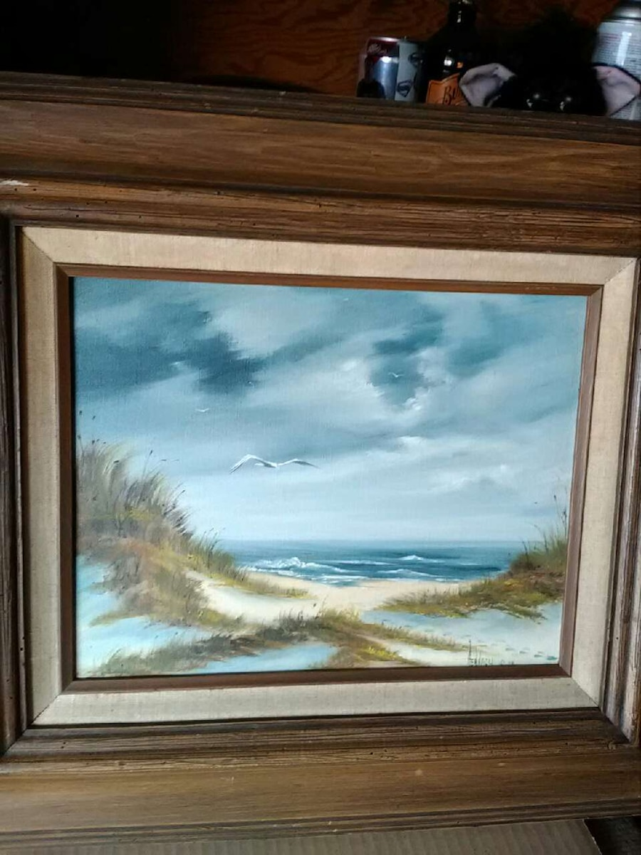 rectangular brown wooden frame sea gulls flying above the body of water painting