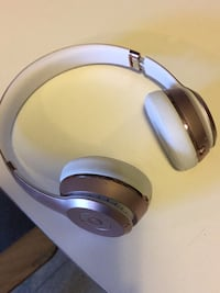 white and blue wireless headphones St. Catharines, L2S
