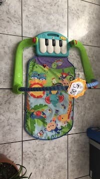 baby's green and white Fisher-Price bouncer El Paso