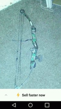 black and green compound bow 212 mi
