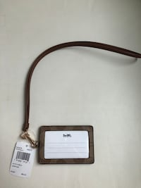 brown monogrammed Coach leather wristlet Toronto, M1N 2R5