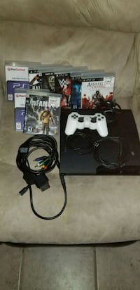 black Sony PS3 slim console with controllers and game cases Las Vegas, 89142
