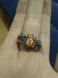 Tirw opal , ruby, & topaz ring
