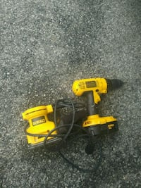 two red and black cordless power tools 55 km